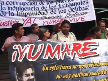 Demonstranten fordern die Aufarbeitung des Massakers von Yumare