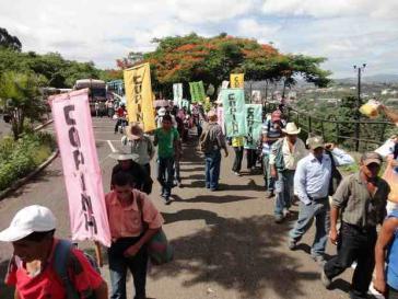 COPINH-Aktivisten demonstrieren am Weltumwelttag gegen Privatisierung und Ausplünderung der natürlichen Ressourcen