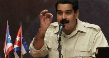 Präsident Maduro, hier mit den Fahnen von Puerto Rico und Kuba