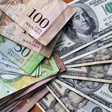 Bolívar- und US-Dollarscheine