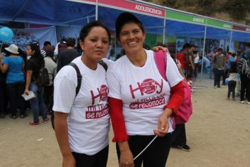 """""""Jetzt wird meine Arbeit anerkannt"""": Hausfrauen tragen den Slogan der IESS-Kampagne auf ihren T-Shirts"""