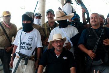 Der Kommandant der Fuerza Rural von La Ruana, Hipólito Mora, (vorn sitzend) und einige seiner Mitstreiter