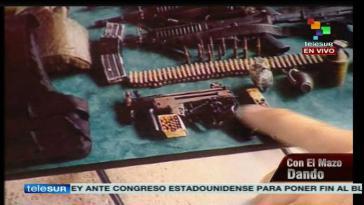 Bei einer Hausdurchsuchung sichergestellte Waffen und Munition