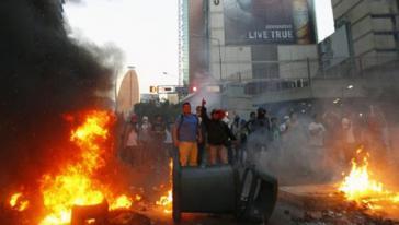 Straßenproteste im Februar 2014: Wegen Anstiftung zu Gewalt sitzt Oppositionspolitiker López im Gefängnis