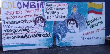 """Ein Wandbild in Kolumbien verweist auf die Opfer des Konfliktes und fordert """"Frieden mit sozialer Gerechtigkeit"""""""