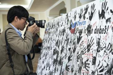 """Kampagne gegen Chevron in Ecuador: """"Schmutzige Hände"""""""