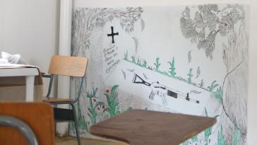 """Wandbild in einer Normalisierungszone der Farc: """"Beerdigen wir unsere Waffen auf dass neue Hoffnung daraus erwachse"""""""