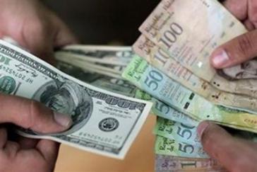 Für einen US-Dollar gibt es in Venezuela nun rund 25.000 Bolívares. Zuvor waren es zehn Bolívares