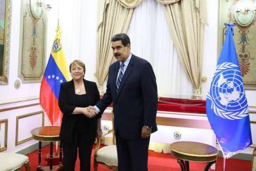 Die UN-Kommissarin für Menschenrechte, Michelle Bachelet, mit dem venezolanischen Präsidenten, Nicolás Maduro