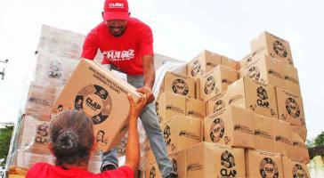 Im Visier der US-Regierung: Lokale Komitees für Versorgung und Produktion bei der Verteilung von Lebensmittelpaketen