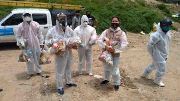 Soziale Organisationen verteilen in Kolumbiens Hauptstadt während der Corona-Pandemie Lebensmittel