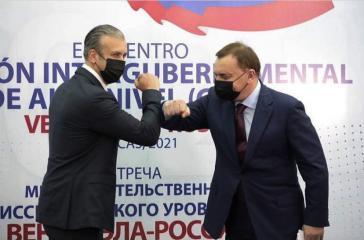 Russlands Vizepremier Borissow und Venezuelas Ölminister El Aissami bei dem Cian-Treffen in Caracas